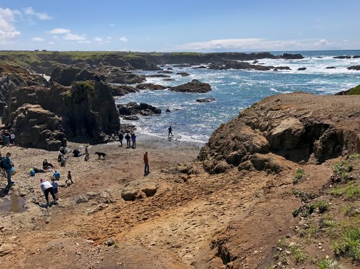 People Treasure Hunting and Looking For Sea Glass At Glass Beach