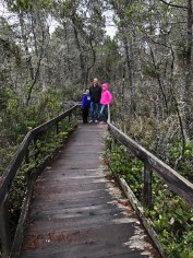 Carter, Brian, and Natalie on the Pygmy Forest Boardwalk at Van Damme State Park