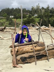Playing With The Driftwood on Big River Beach in Mendocino