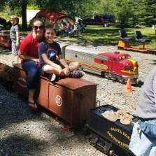 Jennifer and Carter Bourn Riding a Miniature Steam Engine at Hagen Park