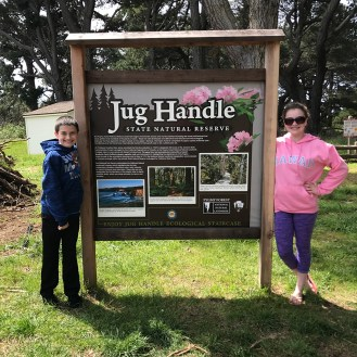 Natalie and Carter at the Jug Handle State Natural Reserve Sign