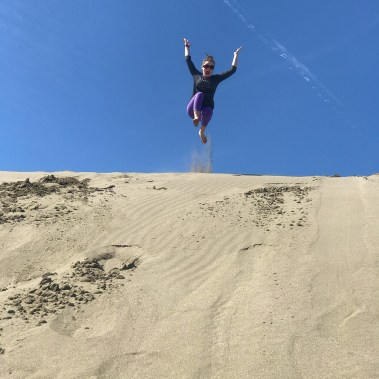 Natalie Bourn Jumping Down Northern California Sand Dunes