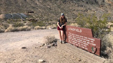 Natalie Bourn in front of the Leadfield Ghost Town Sign