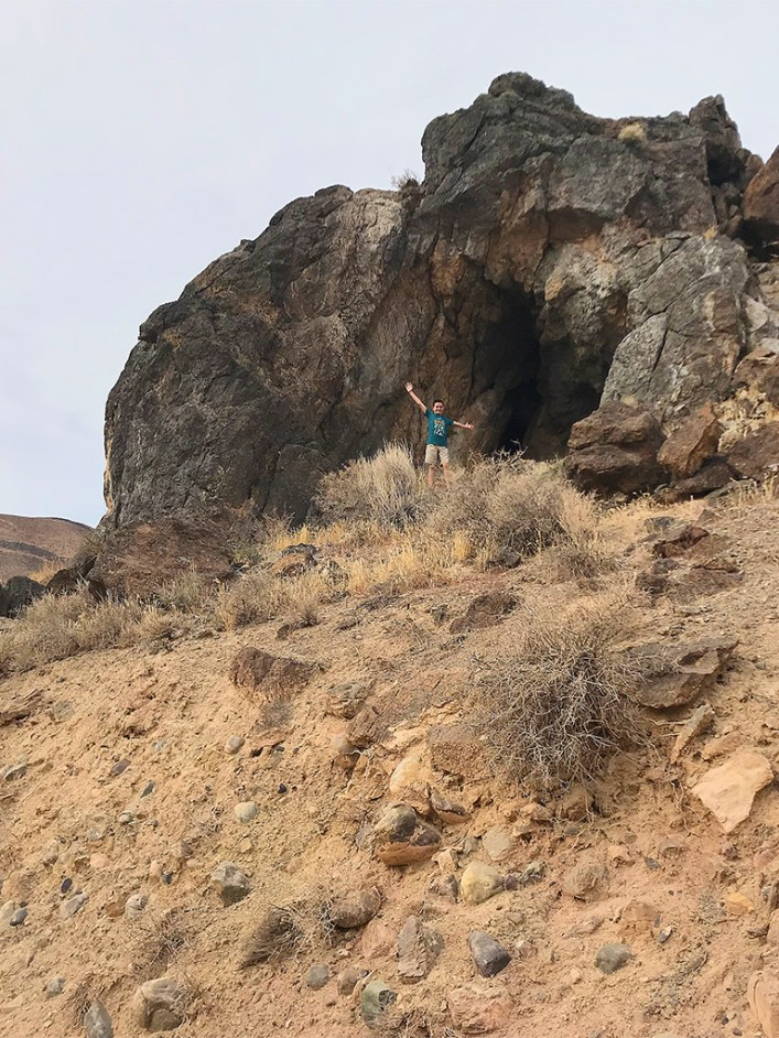 Carter Bourn smapering Over Rocks in Death Valley