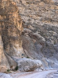 Climbing on Rocks in Titus Canyon Death Valley