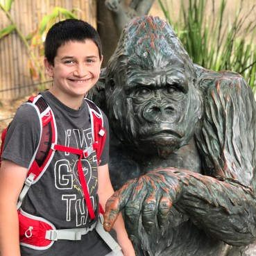 Carter Bourn Posing With a Gorilla Statue
