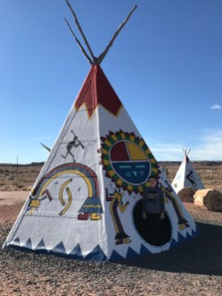 Carter Bourn inside a Tipi at the The Painted Desert Indian Center