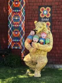 Bear Statue Holding Human Heads