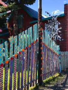 Colorful Painted Fence Decorated With Reflectors