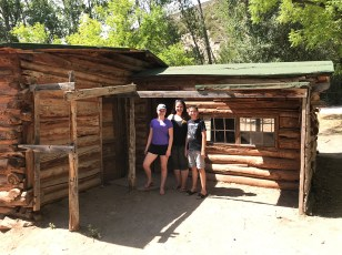 Natalie, Jennifer, and Carter Bourn at the Josie Morris Cabin in Dinosaur National Monument