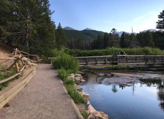 Brian, Natalie, And Carter Bourn a Sprague Lake Nature Trail Bridge
