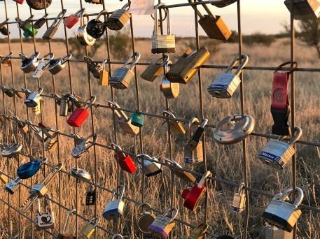 Locks on the fence around Prada Marfa