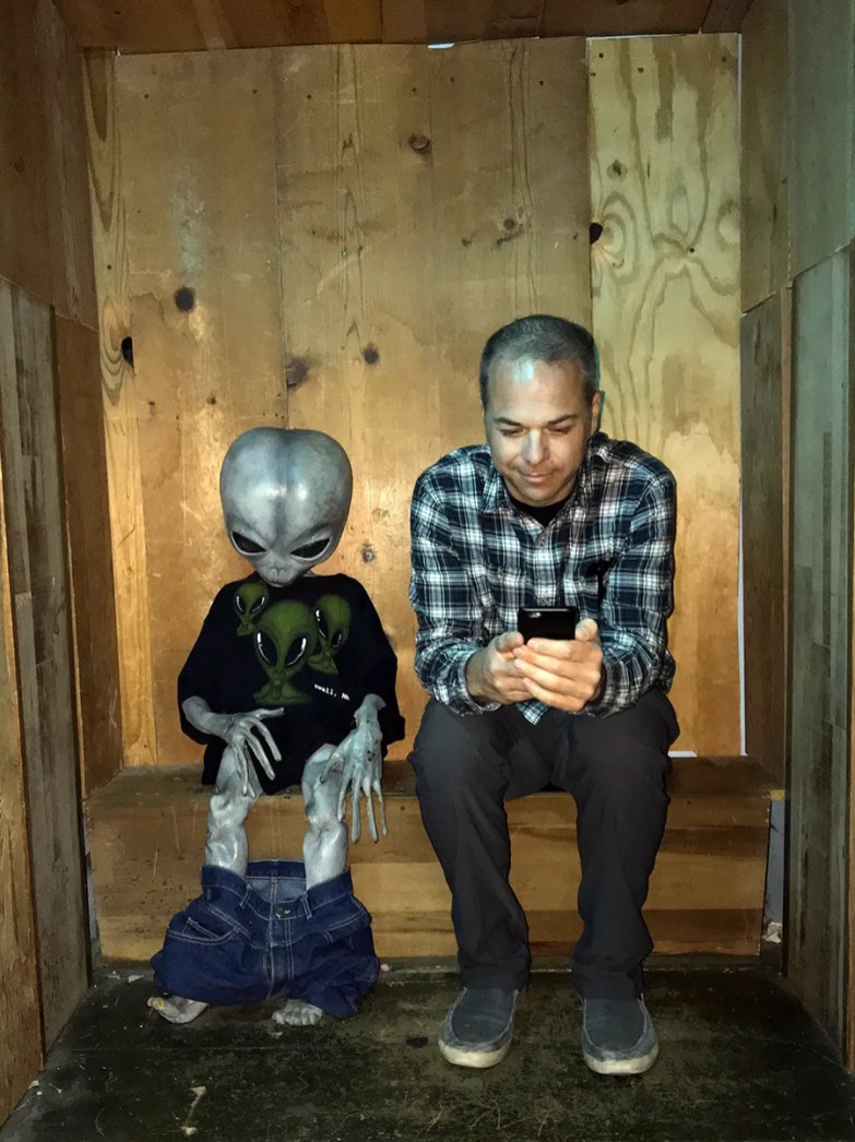 Brian Bourn with an Alien in an Outhouse