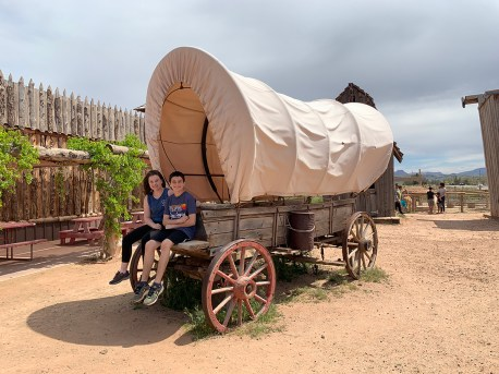 Natalie and Carter Sitting in a Covered Wagon