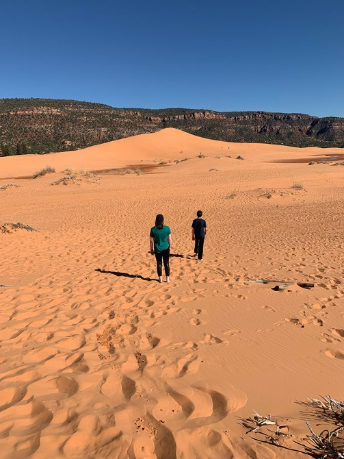 Natalie and Carter Bourn Walking In The Coral Pink Sand Dunes