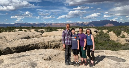 Bourn Family Standing On Top Of A Rock Plateau