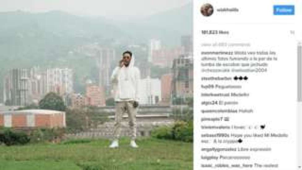 Screengrab from the Instagram account of Wiz Khalifa showing him smoking by the grave of the late Colombian drug lord Pablo Escobar