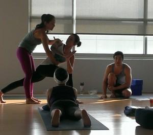Briohny providing an adjustment at Inspire Yoga, Dallas Yoga Studio, in 2013