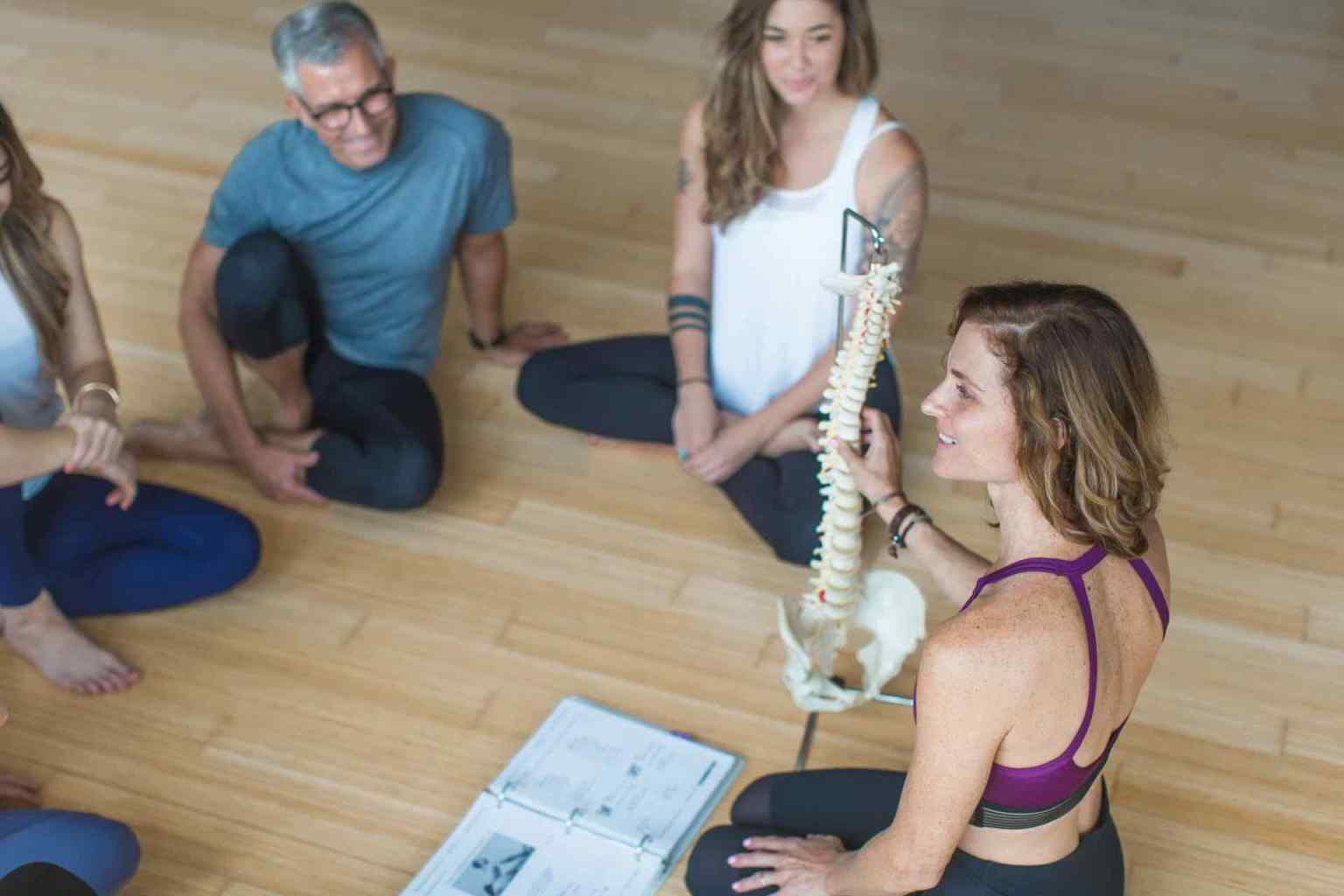 Lead teacher trainer discusses spinal alignment with students