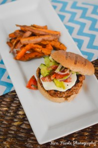 Grilled pesto turkey burger with sweet potato fries.