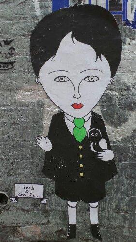 Scaler Street Schoolboy holding a bird