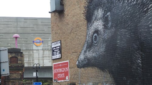 The ROA with Shoreditch High Street station and a Christiaan Nagal mushroom in the background