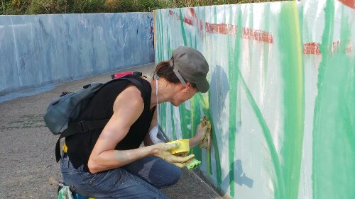 Artist Lorraine was adding reeds and grasses to the mural