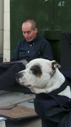 John the Artist and George the Dog in their regular spot on the Shoreditch High Street