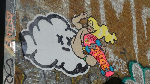 Skateboarding high in the clouds, again on Sclater Street