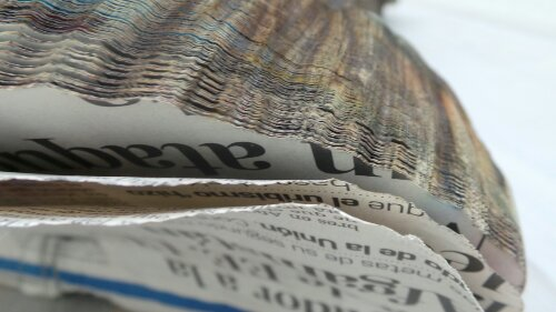 Logs made out of newspaper by Miler Lagos