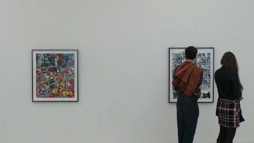Two visitors admire some of the art on display