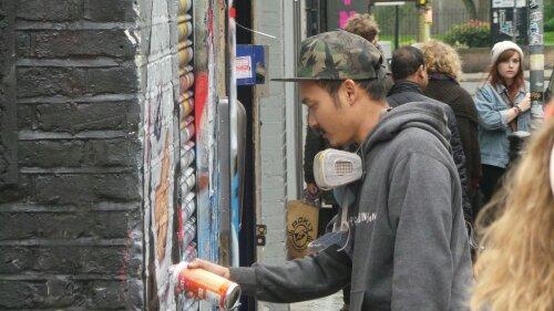 Alex paints a shutter on Hanbury Street