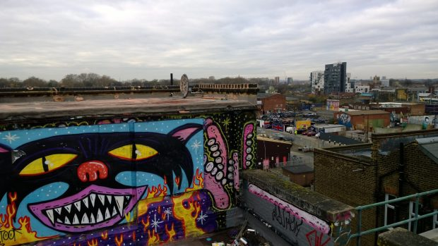 The colourful rooftop doorway with the city in the background