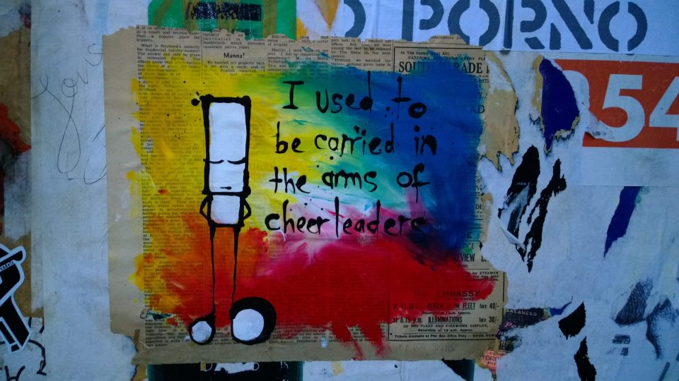 """I used to be carried in the arms of Cheerleaders"" Hug on Redchurch Street"