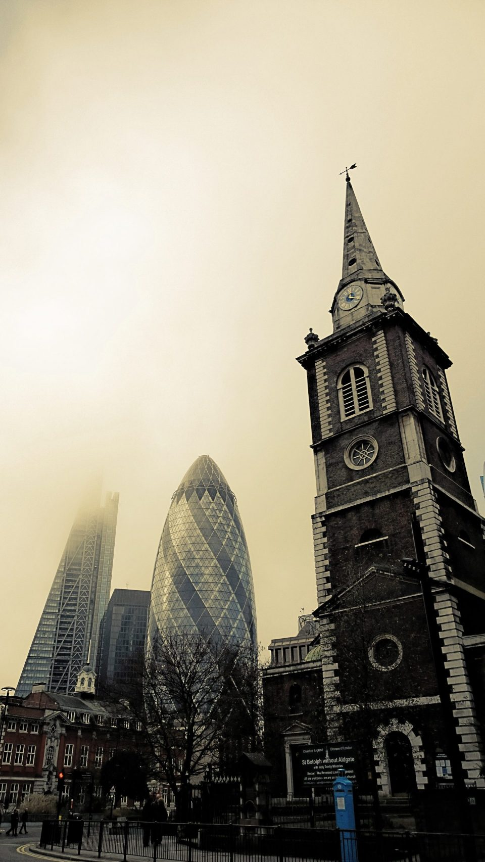 St. Botolph's Church in Aldgate with the Gherkin and the Cheesegrater in the background.  All I did here was add a filter on a foggy day
