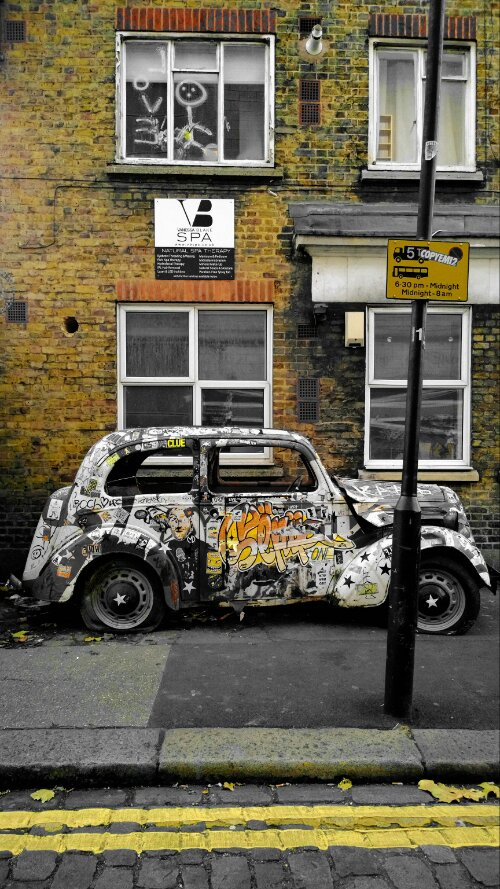 A graffiti daubed car on Haven Street near Camden Lock.