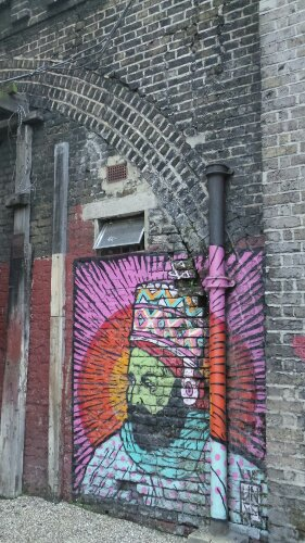 A man by the Broken Fingaz Crew on Coldharbour Lane