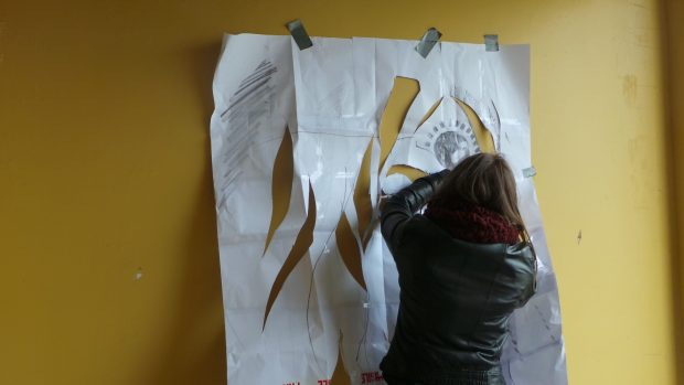 Hannah prepares the stencil for her latest piece