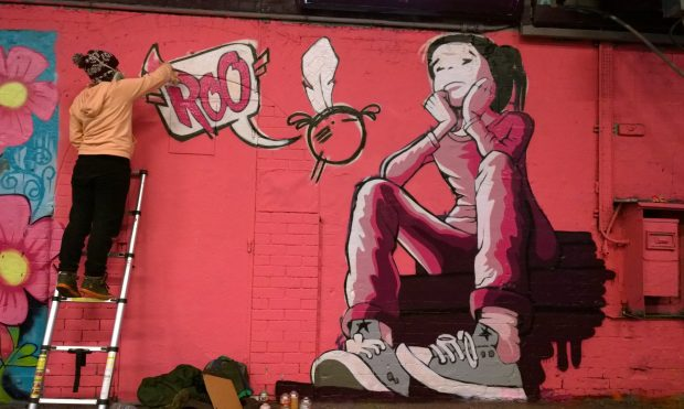 Roo adding the finishing touches to her Femme Fierce mural.  It won the judges prize last year