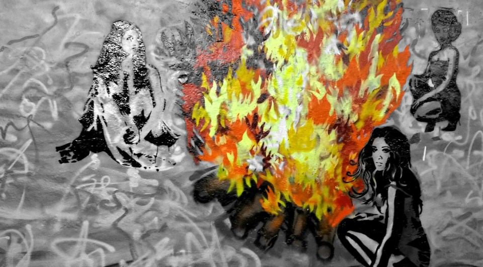 Georgie Georgie created a group of women sitting around a big fire against a swirly colourful background.  I dedcided to try and pick out the fire because I thought it looked really cool