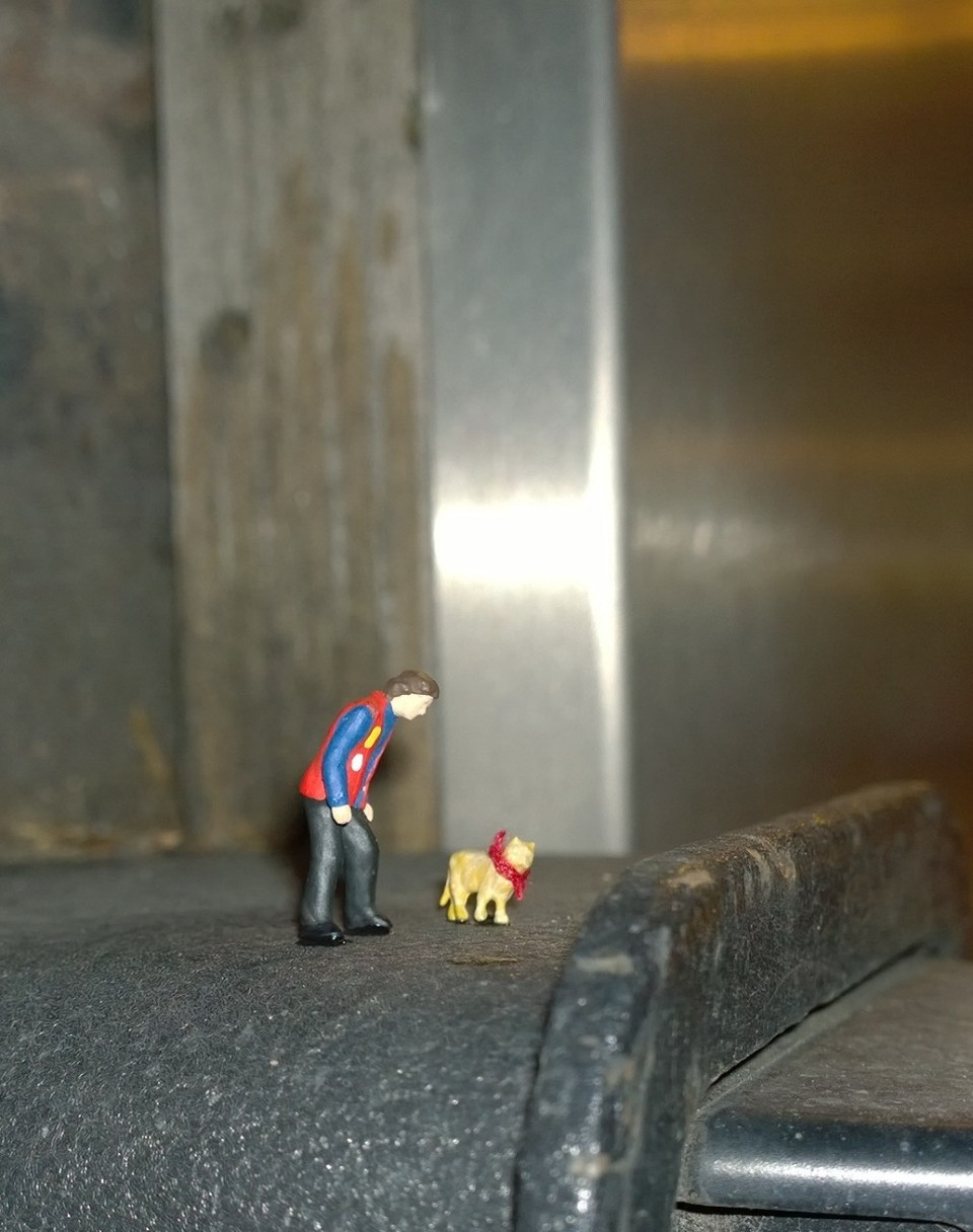 The little figurines of Street Cat Bob and James Bowen on the corner of Long Acre and Neal Street