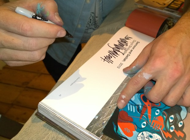 David Shillinglaw signing copies of the book