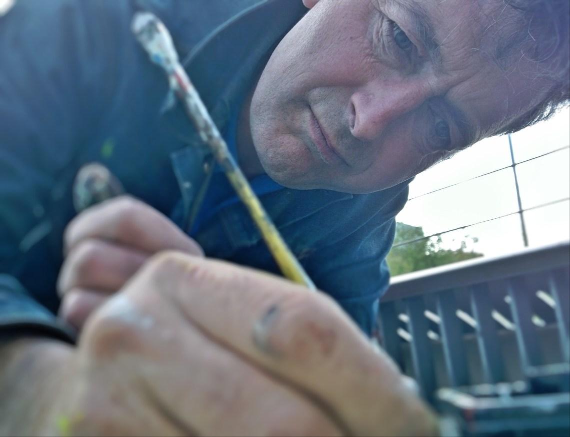 Ben Wilson painting chewing gum on the millenium bridge