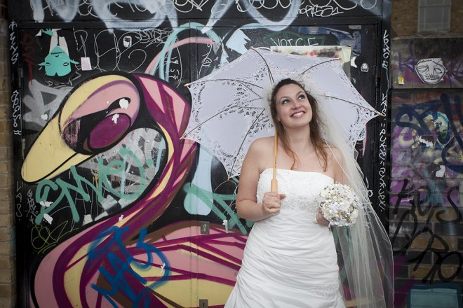 Street Artist and illustrator Stephanie Thieu is more likely to be seen on the Lane with a spray can and not a parasol.  Here she is modelling a wedding dress as part of a photo shoot.