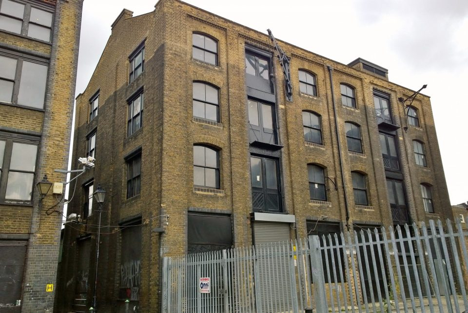 The warehouse on Fleur de Lis Street built in 1927 and at the north end of Blossom Street is proposed to be retained and redeveloped