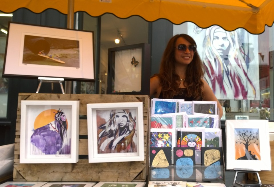 Eleni Duke next to her stall by the Curious Duke Gallery
