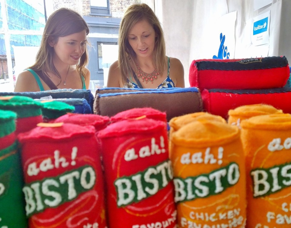 Customers check out some of the felt goods in the Cornershop