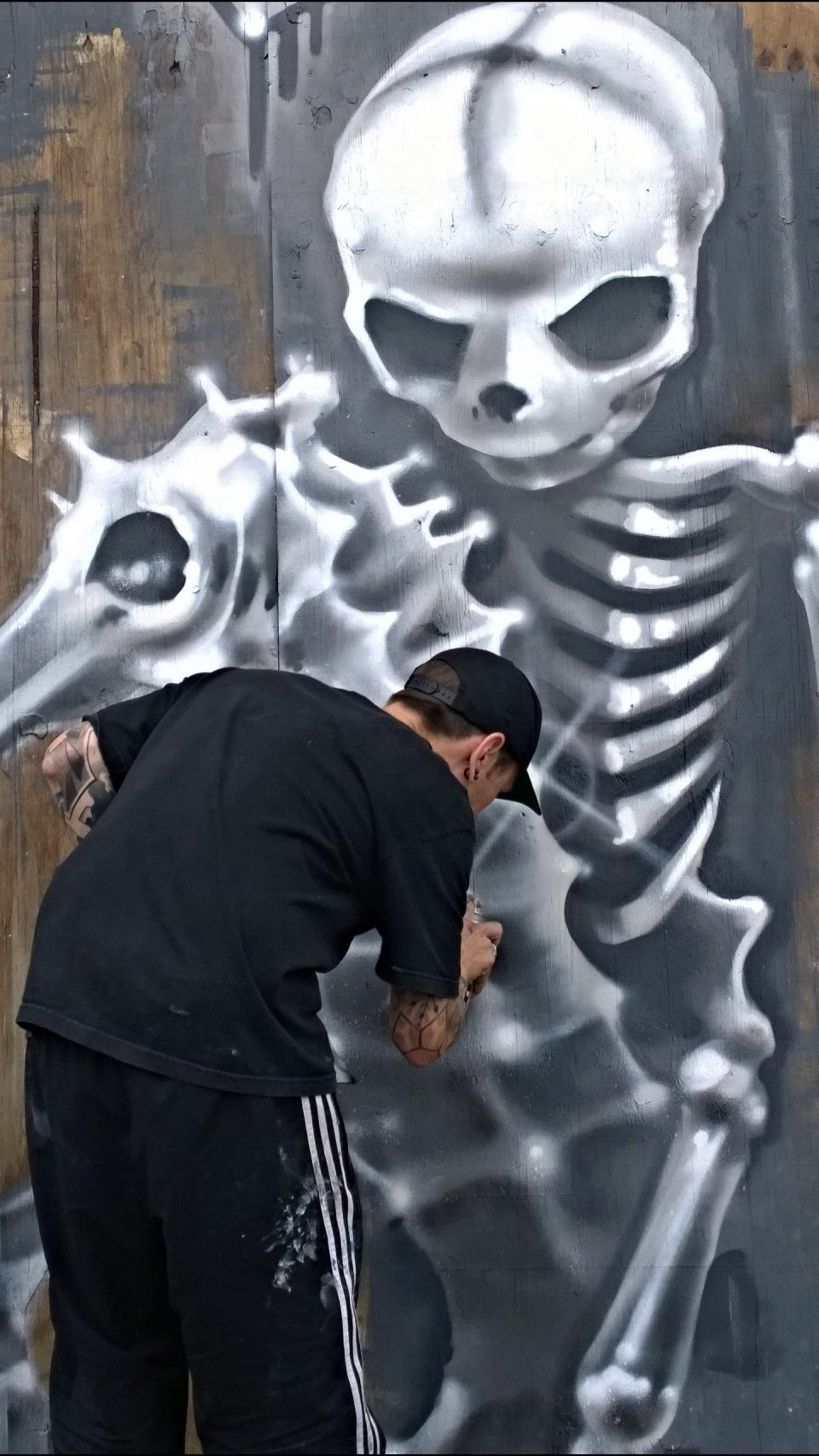Fanakapan in action painting a skeleton riding a seahorse
