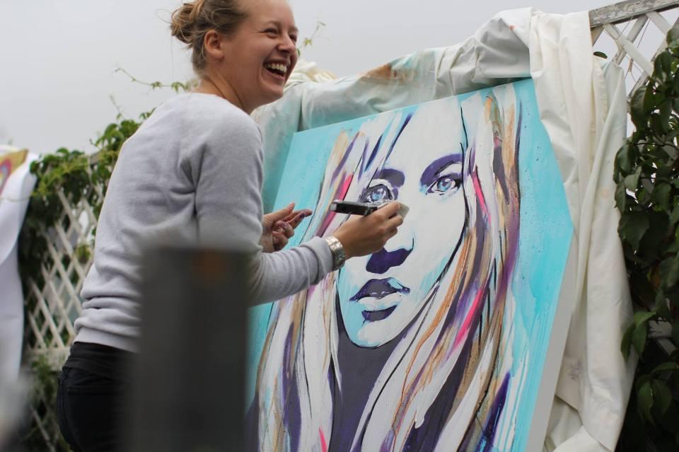 Hannah Adamaszek live painting on the roof courtesy of  International Alert