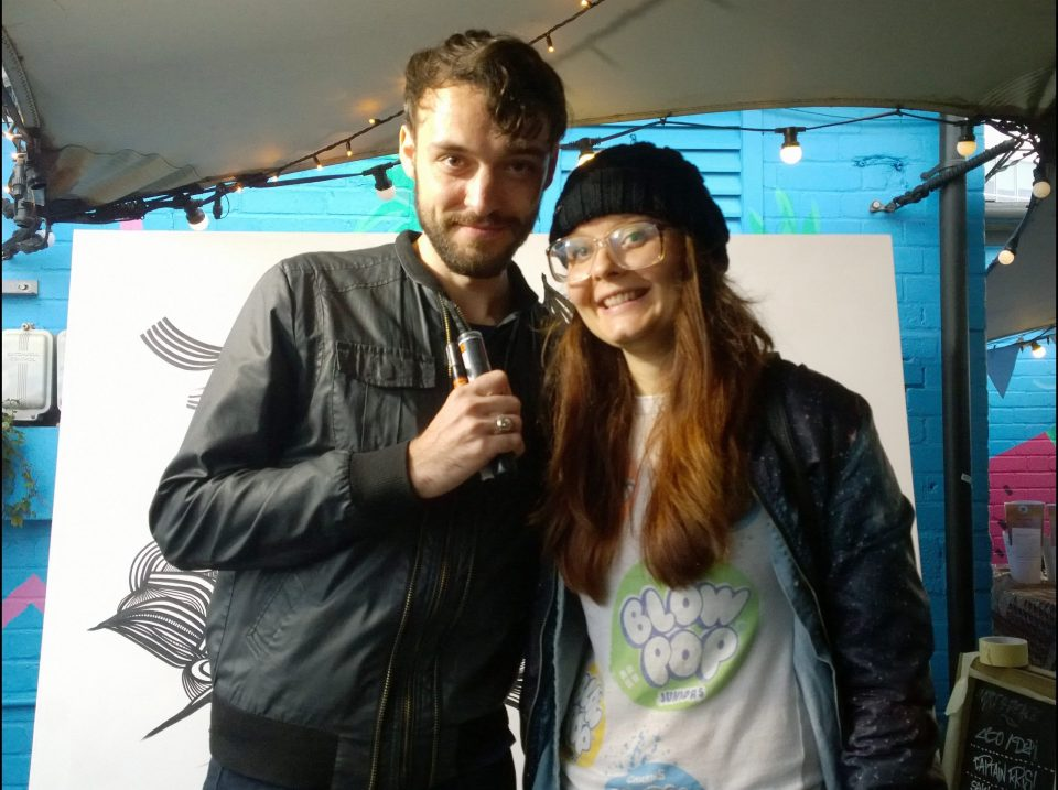 Artista with Kef on the rooftop of the Queen of Hoxton painted as part of international alerts Talking Peace festival